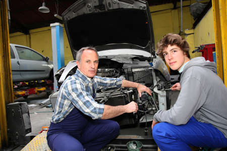 Teenager in professional training in workshop photo