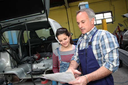 apprenticeship: Portrait of professional and teenager in apprenticeship Stock Photo