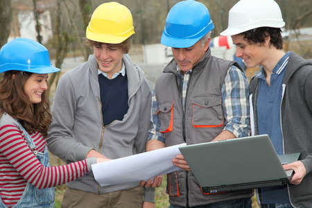 craftmanship: Adult with group of teenagers in professional training