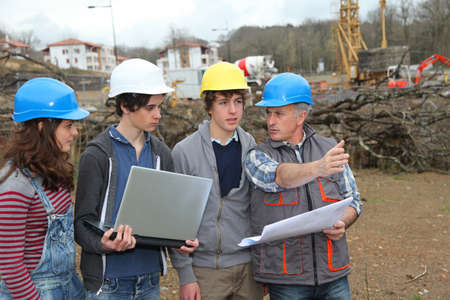 apprentice: Adult with group of teenagers in professional training