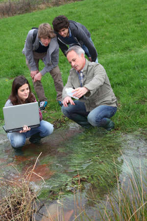 researcher: Teenagers in environmental professional training  Stock Photo