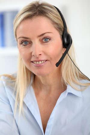 teleoperator: Closeup on blond woman with headset on Stock Photo
