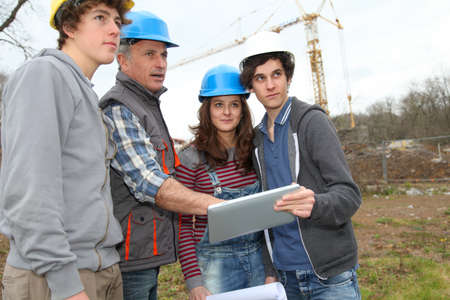 apprenticeship: Adult with group of teenagers in professional training
