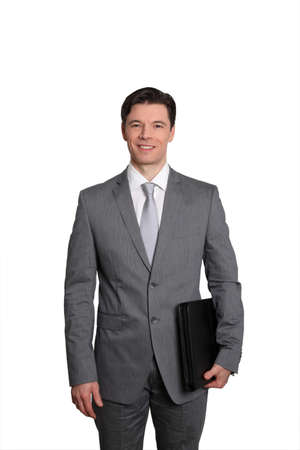 Businessman standing on white background photo