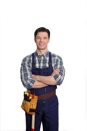 Carpenter standing on white background with arms crossed Stock Photo - 9097754