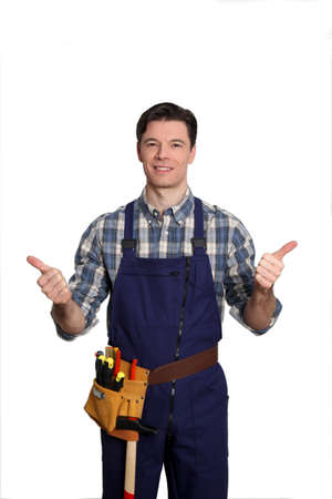 Carpenter standing on white background with thumbs up Stock Photo - 9097752