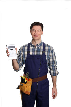 Carpenter standing on white background with calculator Stock Photo - 9097530