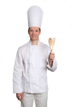 Chef standing on white background with kitchen cutlery photo