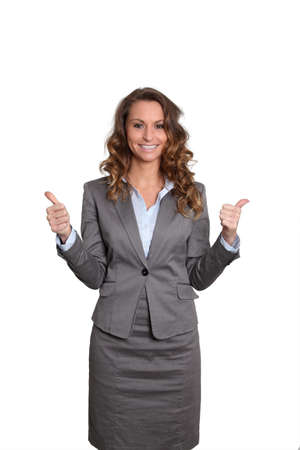 saleswoman: Businesswoman standing on white background with thumbs up