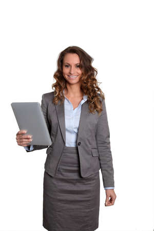 touchpad: Businesswoman standing on white background with touchpad Stock Photo