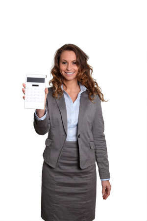 Businesswoman standing on white background with calculator Stock Photo - 9098028