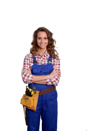 craftswoman: Woman carpenter standing on white background