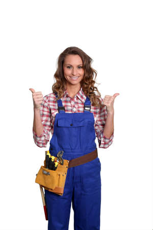 Woman carpenter standing on white background Stock Photo - 9097800