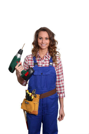 Woman carpenter standing on white background photo