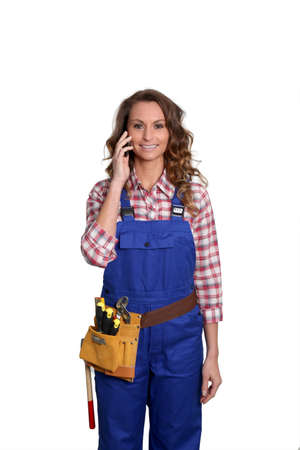 phonecall: Woman carpenter standing on white background