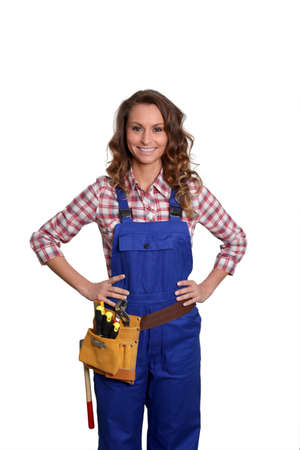 Woman carpenter standing on white background Stock Photo - 9097945