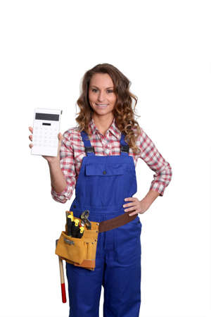 Woman carpenter standing on white background Stock Photo - 9097804