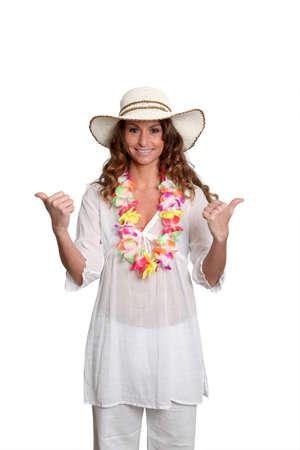 Happy woman wearing hawaiian outfit photo