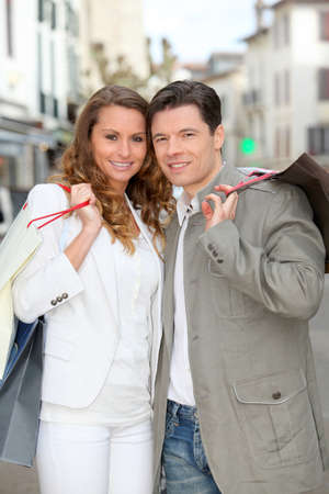 Couple holding shopping bags in town Stock Photo - 9098042
