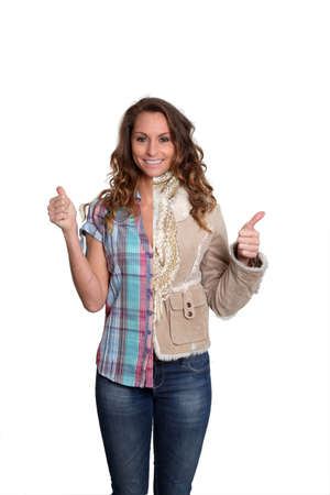 Woman with summer and winter clothes photo
