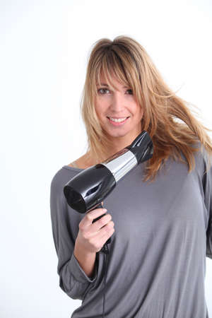 Beautiful woman with hairdryer on white background Stock Photo - 9252597