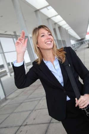 hailing: Businesswoman hailing a cab