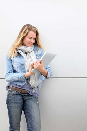 Blond woman using electronic tablet  photo