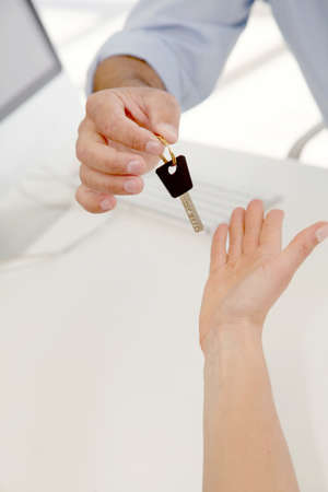 Closeup on hands giving car key Stock Photo - 9347495