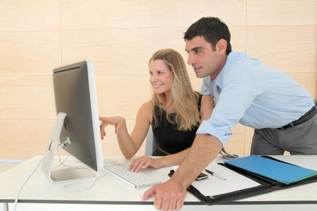 Business people in office working on computer photo