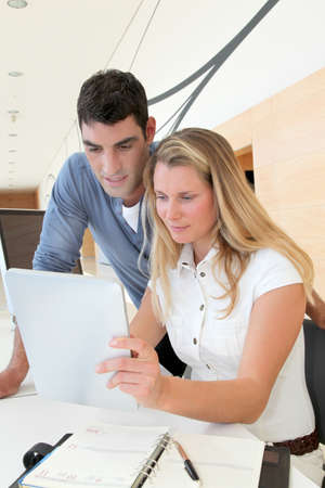 Office workers in office with electronic tablet photo