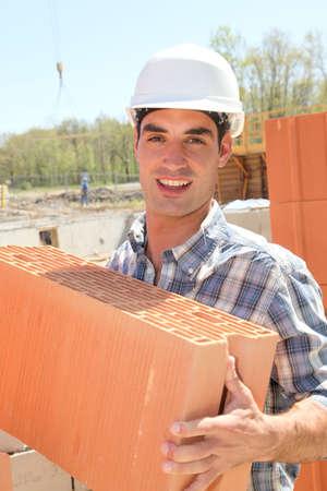 btp: Portrait of smiling bricklayer