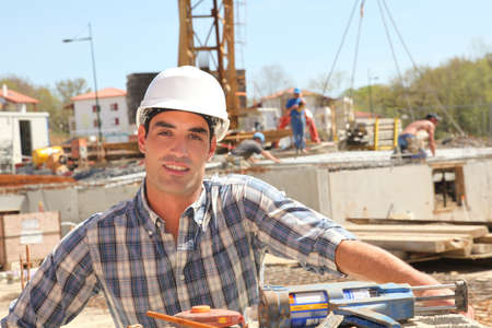 Construction worker standing on building site photo