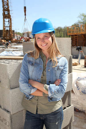 building site: Woman engineer standing on building site Stock Photo