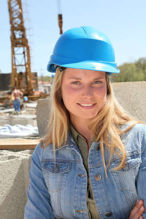 Woman engineer standing on building site photo