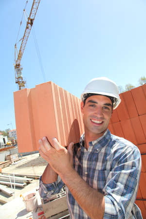 Portrait of smiling bricklayer photo