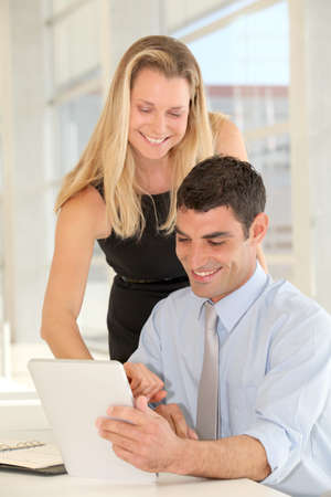 Business people in the office with electronic tablet photo