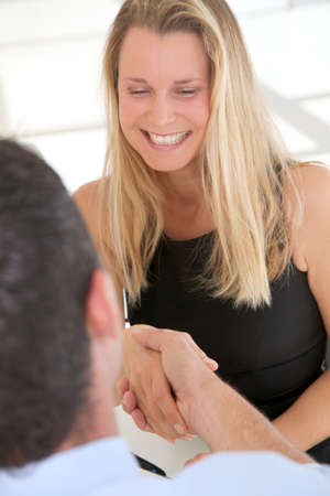 Woman shaking hand for business collaboration photo