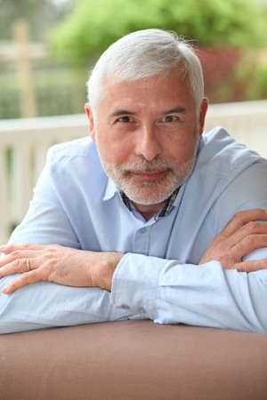 Portrait of smiling senior man photo