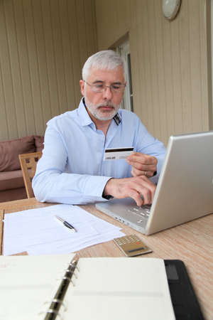 secured payment: Senior man doing online shopping Stock Photo