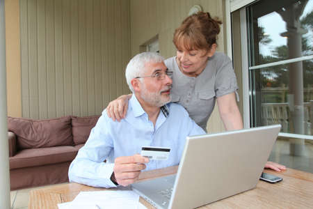secured payment: Senior couple doing online shopping