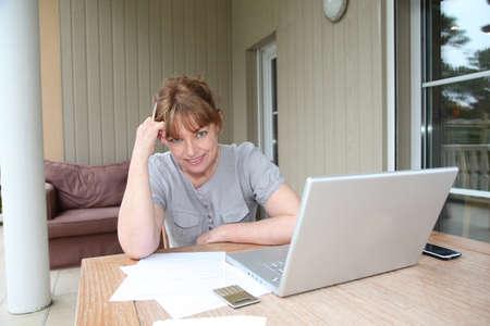 declaration: Senior woman having trouble with tax declaration Stock Photo