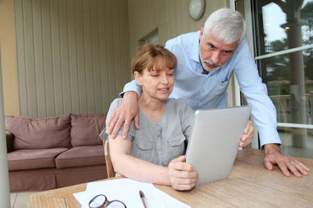 Senior woman using electronic tablet at home Stock Photo - 9480019