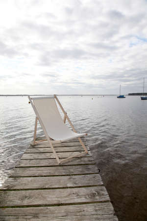 pontoon: View of deck chairs set on a lake pontoon Stock Photo