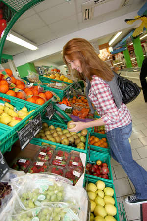 Woman at the grocery store buying fruits and vegetables Stock Photo - 9480312