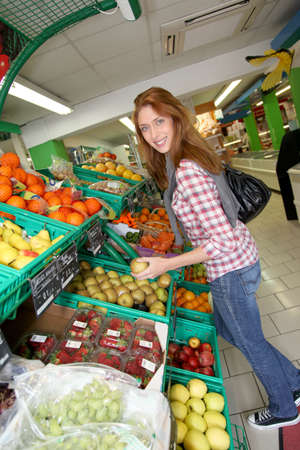 Woman at the grocery store buying fruits and vegetables Stock Photo - 9480309