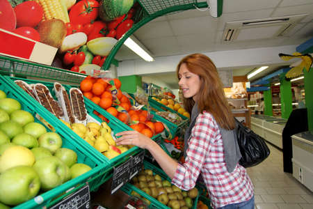 Woman at the grocery store buying fruits and vegetables Stock Photo - 9480302