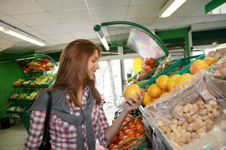 Woman at the grocery store buying fruits and vegetables Stock Photo - 9480283