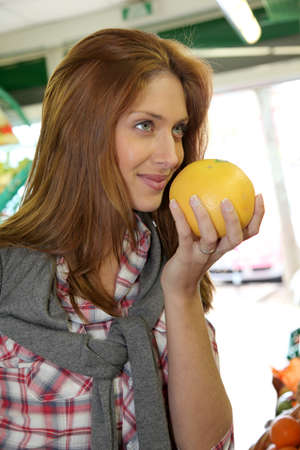Woman at the grocery store buying fruits and vegetables Stock Photo - 9480305