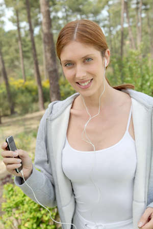 Beautiful woman jogging in forest Stock Photo - 9479128