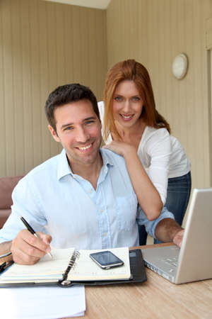Self-employed man working at home with wife Stock Photo - 9478871